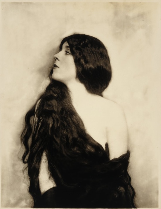 Alfred Cheney Johnston- Model with long hair, circa 1920
