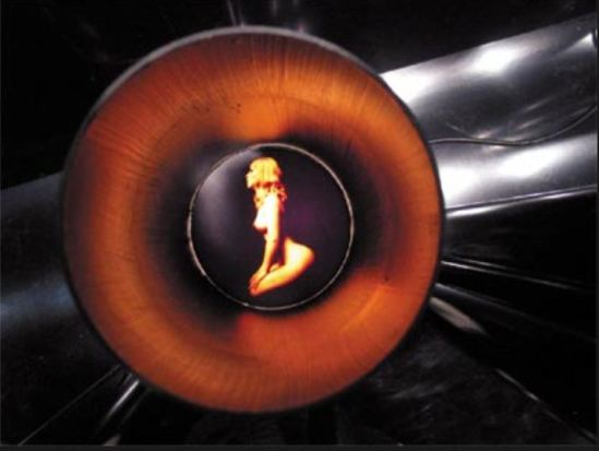 the polaroid of carlo mollino is presented inside the metal tube for the expossition Mollino fragments, Triennale de Milan, 2005