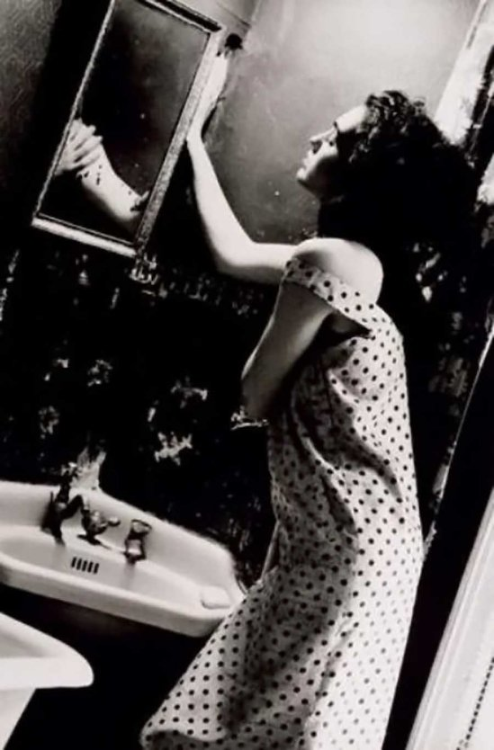 David Seidner-Woman looking in mirror, 1986