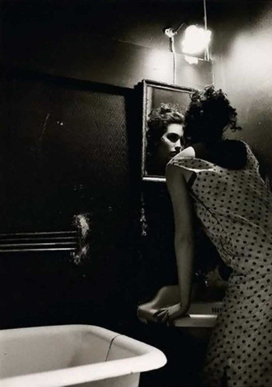 David Seidner-Woman looking in mirror, 1986