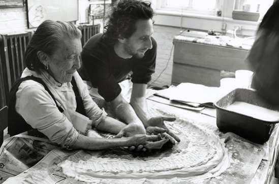 Louise Bourgeois and her assistant Jerry Gorovoy in her Brooklyn studio preparing to make a mold for a sculpture in 1995