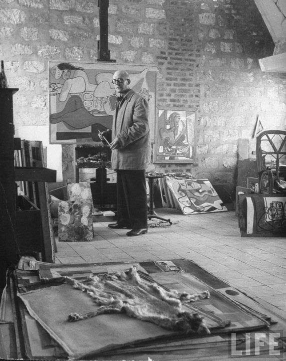 Architect Le Corbusier working on project for French project