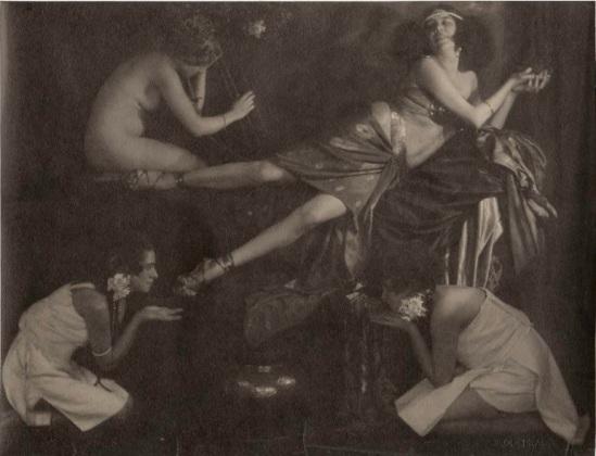 frantisek-drtikol-the-dancer-ervina-kupferova-dressed-as-a-princess-adored-by-two-servants-1919-phraha-pigment-print