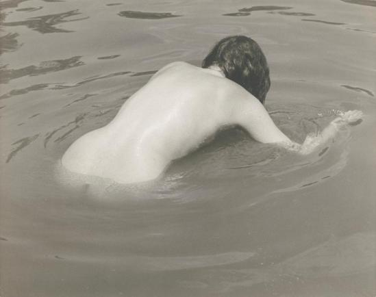 Josef Breitenbach -back of female nude bending over in water, Sept. 1961 © The Josef Breitenbach Trust