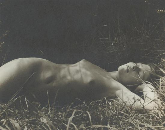 Josef Breitenbach-nude girl lying in gras, 1950s