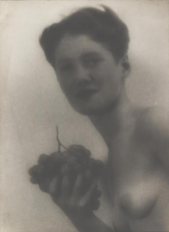 Josef Breitenbach-soft-focus bust of nude woman holding grapes, Paris, . 1933