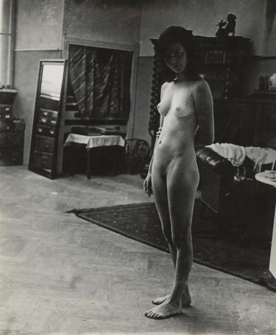 Josef Breitenbach-standing female nude - front view, furnishings, 1932