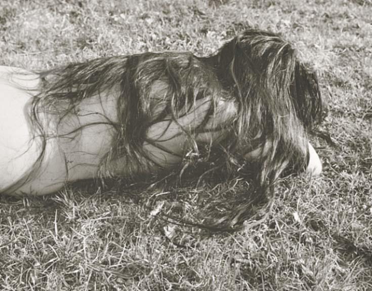 Josef Breitenbach- Untitled ,  (Female nude with long dark hair, lying face-down on grass,) USA , 1961 © The Josef Breitenbach Trust