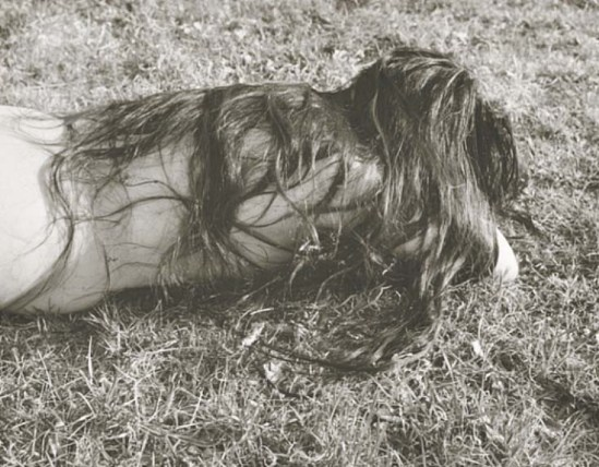 Josef Breitenbach- Untitled ,  (Female nude with long dark hair, lying face-down on grass,) USA , 1961 © The Josef Breitenbach Trust