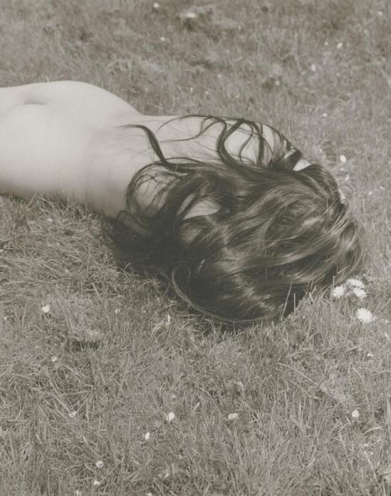 Josef Breitenbach-untitled ,female nude with long dark hair lying face-down on grass , USA  1961