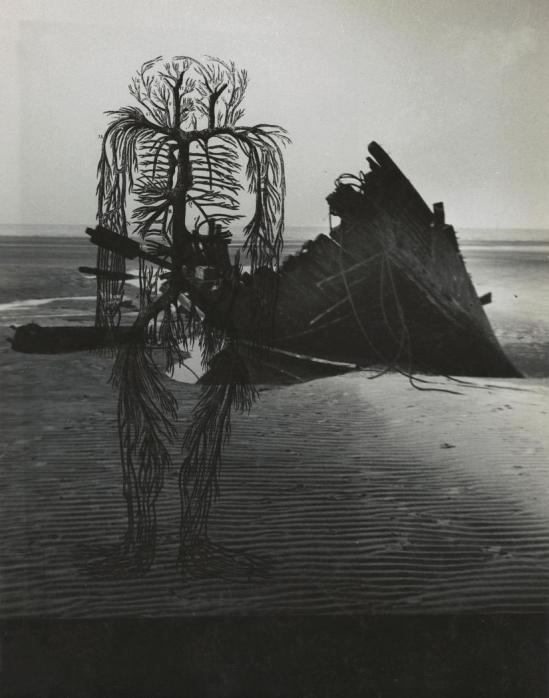 Josef Breitenbach-untitled , human circulatory system diagram, dark beach scene with wrecked boat,  1942  © The Josef Breitenbach Trust