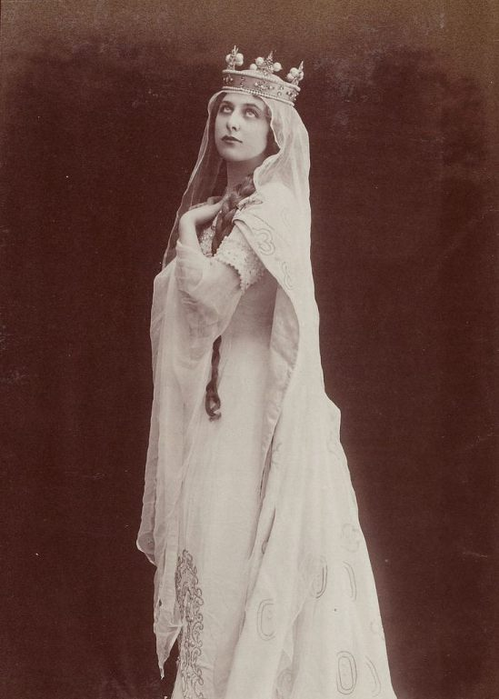 Geraldine Farrar as as Elizabeth in Tannhäuser, by reutlinger around handing colored,around 1910s edited By GG( first representation was at the Metropolitan Opera House February 6, 1907