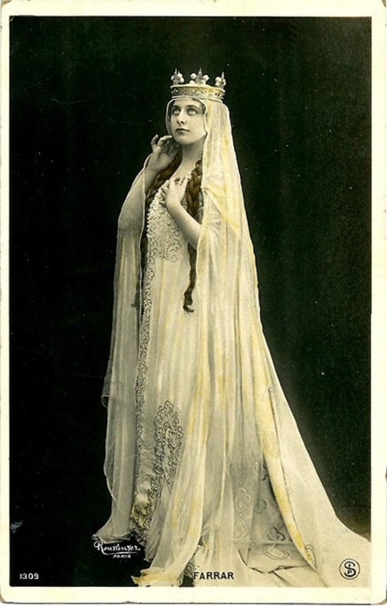 Geraldine Farrar as as Elizabeth in Tannhäuser, by reutlinger around handing colored,around 1910s edited By Sapi ( first representation was at the Metropolitan Opera House February 6, 1907