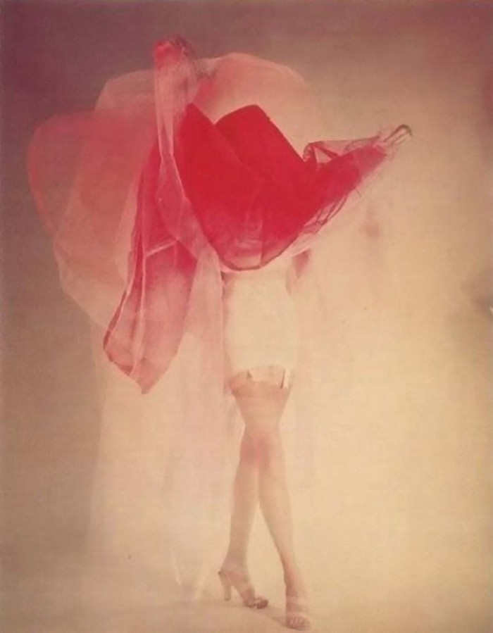 Edwin Blumenfeld - Ruth Knowles in undergarments, photographed, 1955