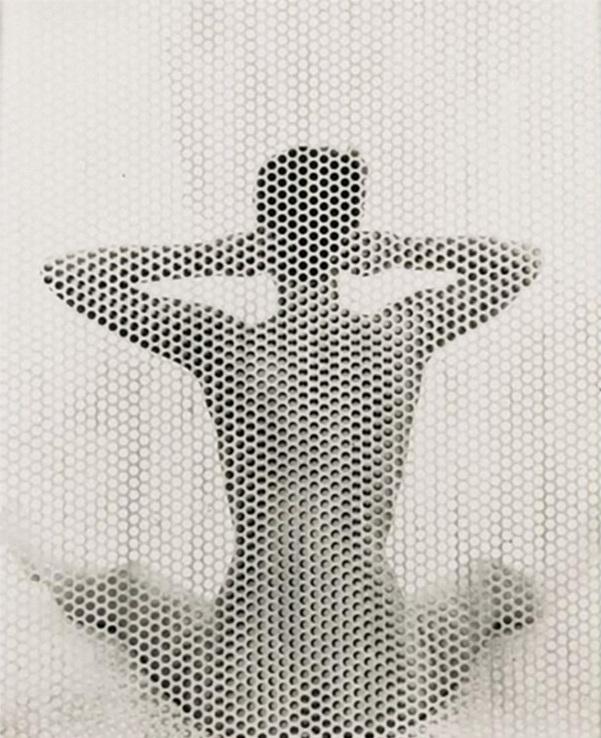 Erwin Blumenfeld -Seated Nude behind perforated screen, New York, 1955