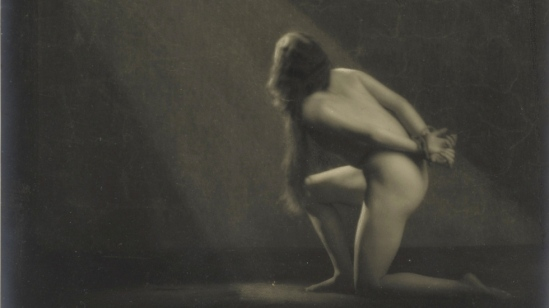 Waldemar Eide - Female act on his knees behind the bound hands, ca. 1919)