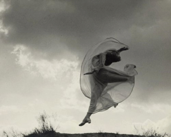 Franz Fiedler- the dancer sarah jankelow jumping in front of clouds, 1926