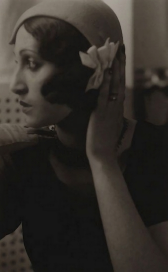 Jacques Henri-Lartigue - Renée Perle with hand on hat, 1930
