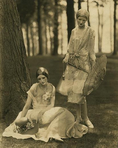 Edward Steichen -Models Marion Morehouse (in a bouffant dress) and the actress Helen Lyons (in a long sleeve dress by Kargère) // masks by the illustrator W.T. Benda, 1926.