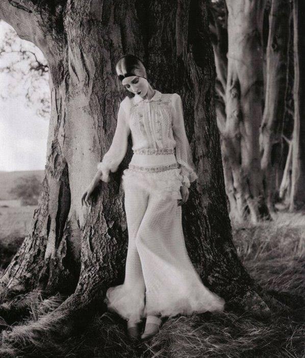 Edward Steichen -Model Marion Morehouse (dress by Kargère) // masks by the illustrator W.T. Benda, 1926