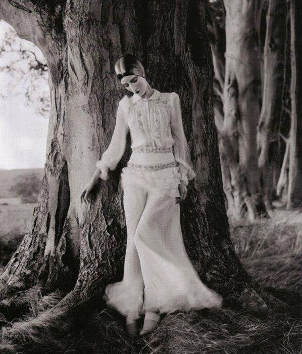 Edward Steichen -Model Marion Morehouse (dress by Kargère) // masks by the illustrator W.T. Benda, 1926