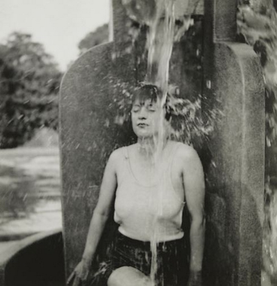 Curtis Moffat-Woman under water spout, about 1925
