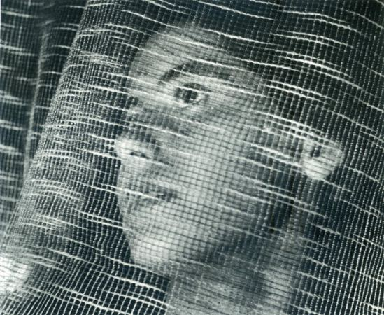John Gutmann- Face Behind Curtain, 1937 © Arizona Board of Regents