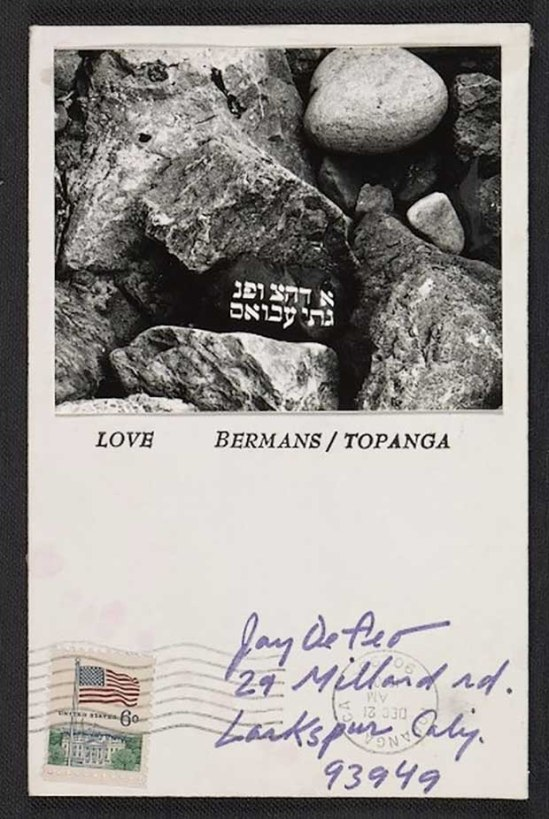 Wallace Berman- mail art for Wallace Berman holiday card to Jay DeFeo, 1970 Dec. 22.,Card features a black and white photo of rocks with white lettering in Hebrew Archives of American Art,