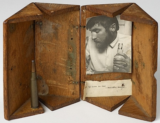 Wallace BermanUntitled (Art is Love is God), 1955, Robert Alexander. Wooden box, photograph, bullet, and paper ourtesy of Galerie Frank Elbaz and Michael Kohn Gallery.