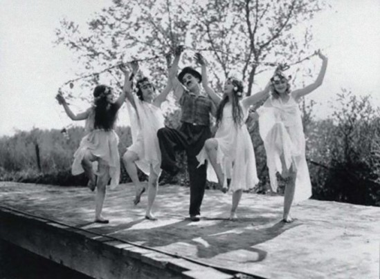 Charlie Chaplin with Olive Ann Alcorn, Edna Purviance, Willie Mae Carson, & Helen Kohn as 'The Nymphs' in Sunnyside,1919