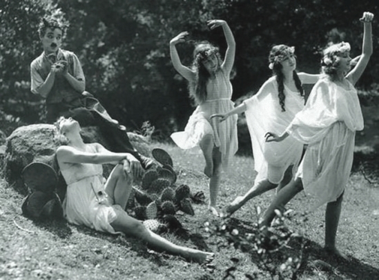 Charlie Chaplin with Olive Ann Alcorn, Edna Purviance, Willie Mae Carson, & Helen Kohn as 'The Nymphs' in Sunnyside,1919