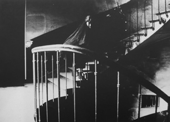 Deborah Turbeville, The Staircase – Aurelia Weingarten in Commes des Garcons, Passage Vivienne, Paris, 1980_e
