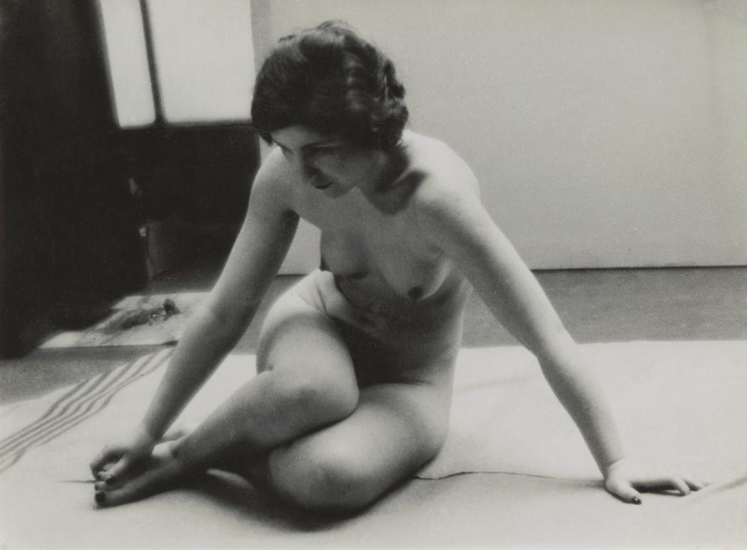 Josef Breitenbach- Female nude sitting on blanket,  1935, Gelatin silver print © The Josef Breitenbach Trust.