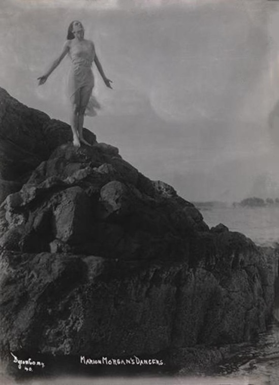 Athur Vitols for Byron Company -One of Marion Morgan's dancers posing on rocks at the beach Rye, New York, 1920