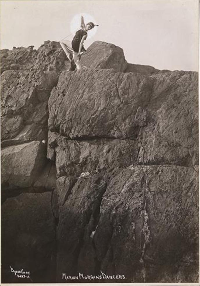 Byron Company - one of the Marion Morgan's Dancers posing on the rock, Rye, New York. , 1920
