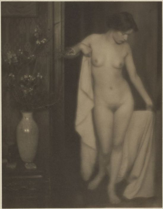 Clarence H. Untitled (Miss Thompson, nude, in doorway holding white fabric),1910