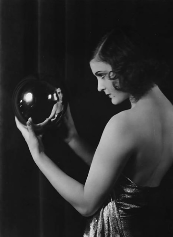 Marika Rokk looking into a crystal ball.1930 by sasha